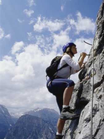 female-mountain-climber-looking-up